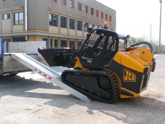 Plant machine driving on to ramps