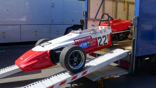 Racing car loading ramps on truck