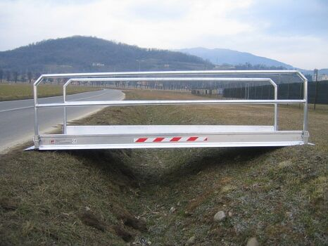 Vehicle gangway over trench side view