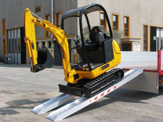 Mini digger on channel ramps