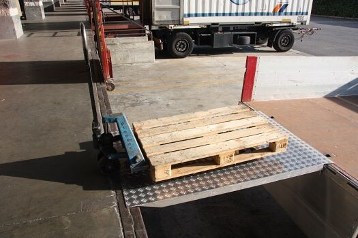 Pallet truck on loading bridge