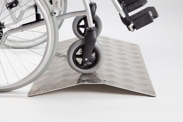Wheelchair on aluminium ramp