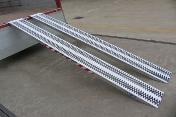 Non folding loading ramps attached to vehicle