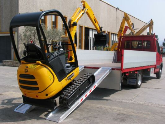Mini digger loading on to truck