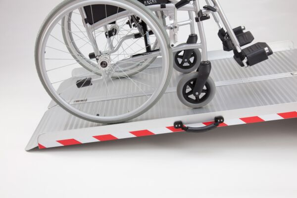 Manual wheelchair on extra wide folding wheelchair ramp